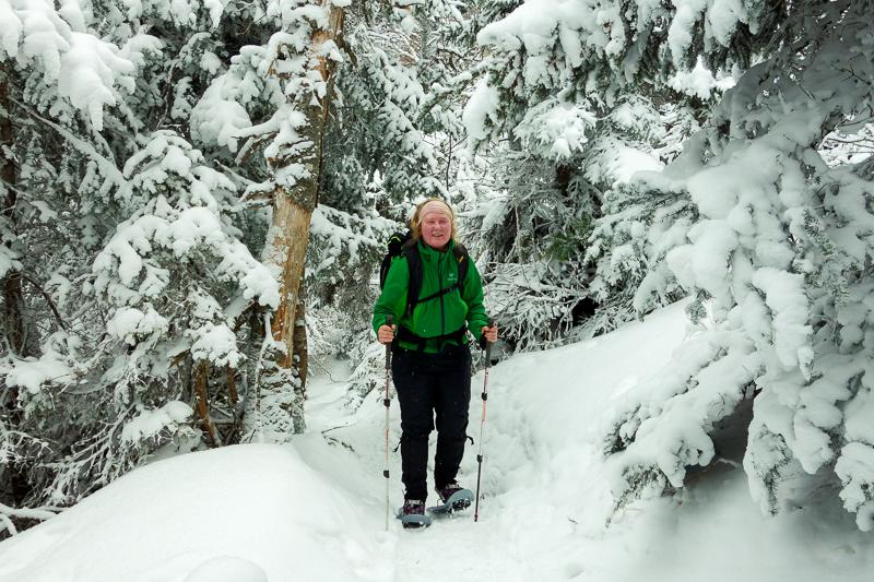 Jenn snowshoeing below treeline