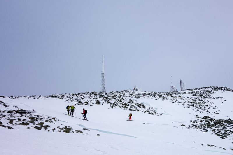 A group of skiers starting their descent