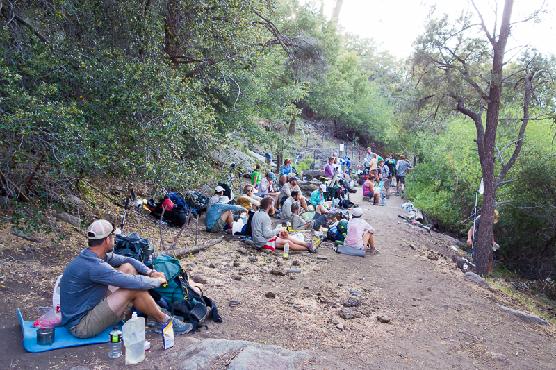 Hikers bunch up for water at Golden Oaks Spring, in the middle of what used to be a 36 mile dry stretch